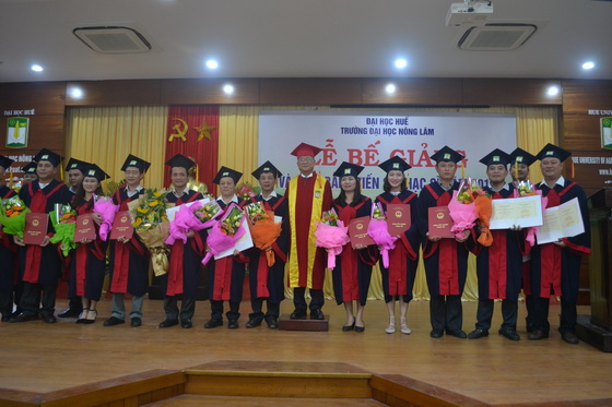 Conferring diplomas to PhDs and Master students of the 21st course